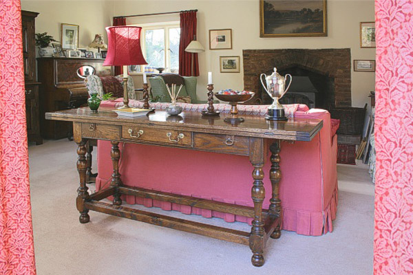 Oak folding table in sitting room of surrey country cottage.