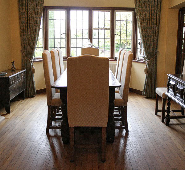 Bespoke narrow fully upholstered side chairs, with antique early oak furniture, in clients Surrey home.