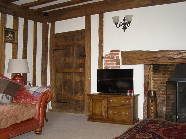 Bespoke oak traditionally styled TV stand, in our clients cosy oak-beamed Suffolk cottage home.