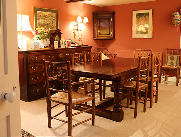 James 1st period style oak drawer-leaf table, in the attractive and cosy dining room of our clients village house in Berkshire.