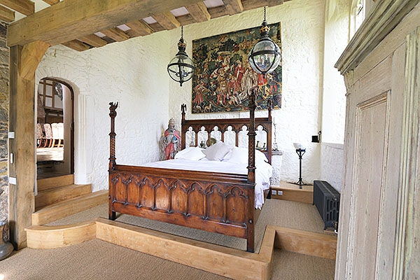 Gothic style carved oak bed in 14th century manor house