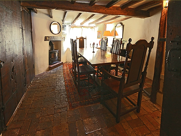 Oak dining table & period style chairs in ancient house