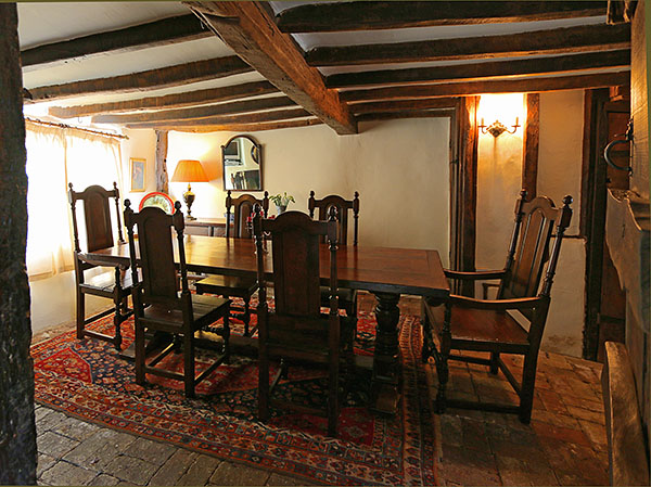 Period Style Oak Dining Table And Chairs In Beamed Room