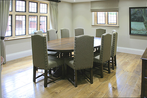 Period style bespoke oak pedestal oval top table and fully upholstered dining chairs, in our clients new stone built country house.