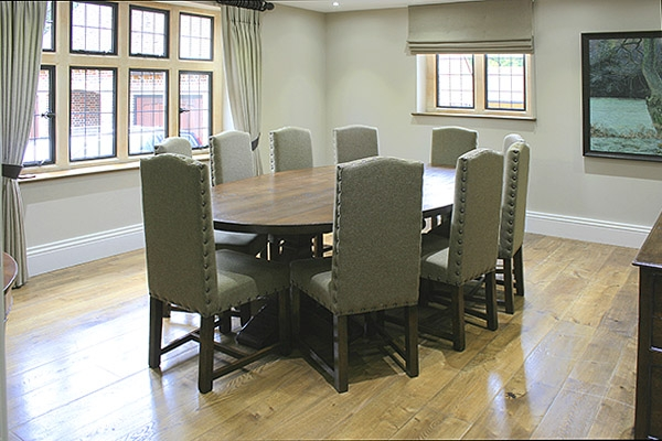 Oak pedestal table & upholstered side chairs in new house