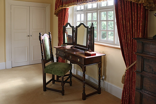 Period style oak dressing room furniture in country house
