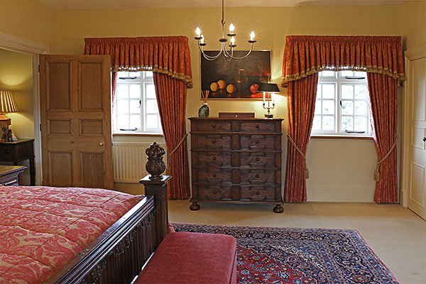 Oak Jacobean style chest of drawers, shown here in the master bedroom of our clients lovely Warwickshire country house.