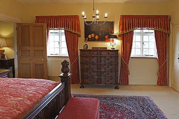 Oak Jacobean style chest of drawers in country house bedroom