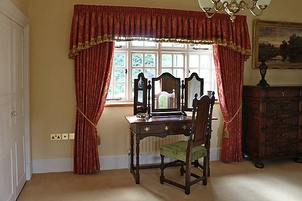Period style oak dressing table, upholstered chair and mirror, shown here in our clients wonderful stone built Warwickshire country home.