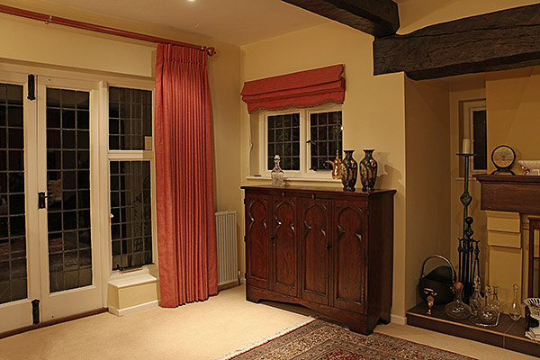 Our clients handmade oak Gothic style TV cabinet, in the sitting room of their Surrey home.