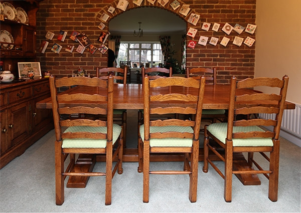 Period style oak table and ladderback chairs in 1930