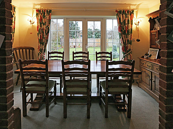 Bespoke oak pedestal table and six ladder back chairs, in the dining room of our clients 1930