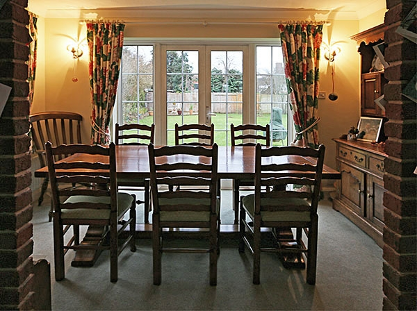 Pedestal dining table & ladder back chairs in 1930