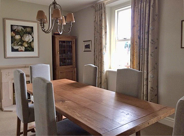 Traditional styled oak pedestal dining table, fully upholstered side chairs and bespoke oak glazed display cabinet, in our Derbyshire clients dining room.