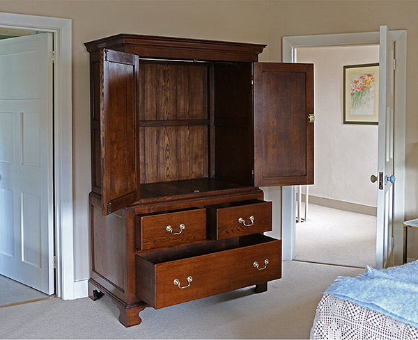Bespoke period style oak linen press, in the master bedroom of our clients Berkshire cottage.