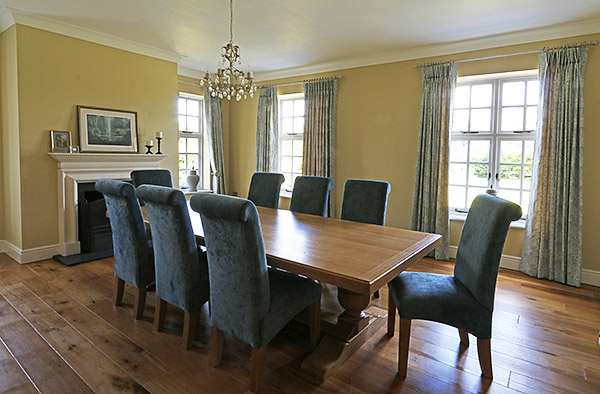 A familiar style of upholstered dining chair, but custom made to suit the un-aged heavy oak table, in our clients Monmouthshire country home.
