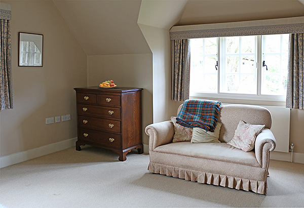 5-drawer period style oak chest of drawers in the large master bedroom of our clients Berkshire cottage.