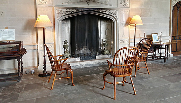 Fruitwood cabriole leg stick back armchairs, displayed in the Great Hall of Lacock Abbey, Wiltshire.