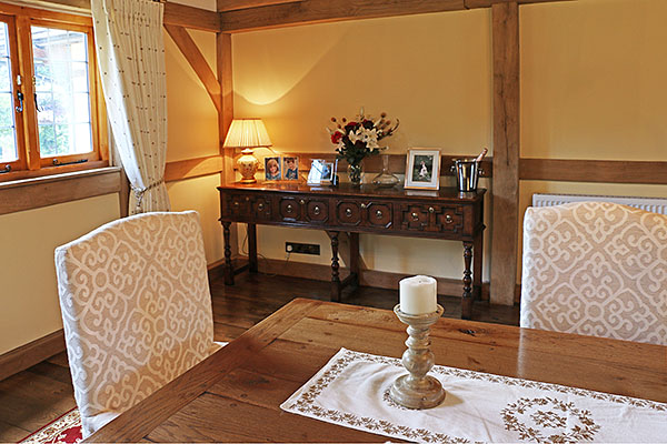 4-drawer Jacobean style oak open dresser base, in the newly built oak framed dining room, of our clients Sussex cottage.