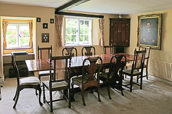 Period style oak extending table in West Sussex cottage