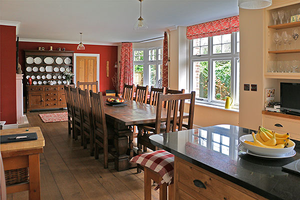 Arts and Crafts style bespoke oak dining table and chairs, in Dorset village house.