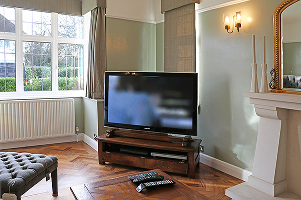 Traditionally styled oak TV stand and special mount, in our clients home in Kent.