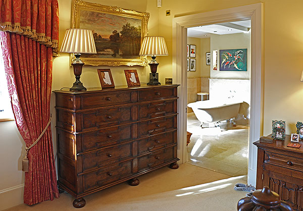 Bespoke large 10-drawer 17th century period style oak chest of drawers in master bedroom of Warwickshire clients country home.
