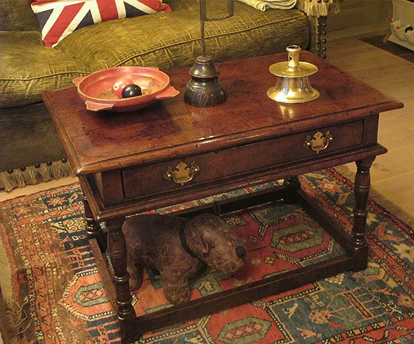 Oak coffee table with drawer in Sweden period interior