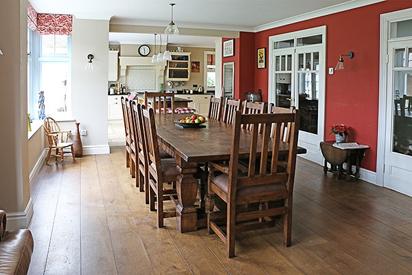 Heavy oak table & matching chairs in traditional interior