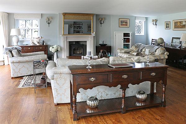 Antique style oak potboard dresser base in sitting room of Sussex farmhouse.