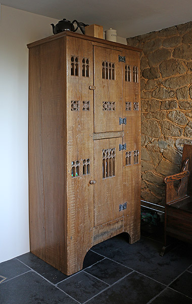 Early 16th century style boarded oak aumbry in the kitchen of our clients Surrey cottage.