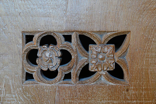 Pierced and carved gothic decoration, for ventilation, in 16th century style boarded oak aumbry.