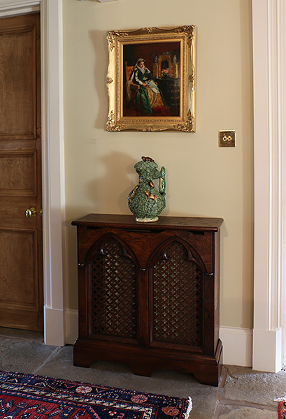 Bespoke made Gothic style 2-panel oak radiator cover in Warwickshire country house hallway.