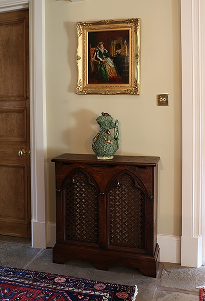 Period style 2-panel oak radiator cover in country house
