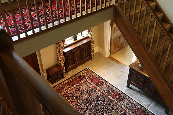 Lutyens inspired oak radiator cover, looking down from the galleried landing of our clients Warwickshire country house.