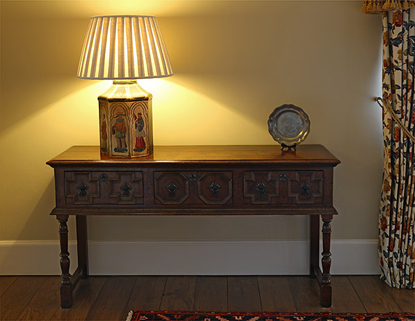 Jacobean style oak dresser in country home.