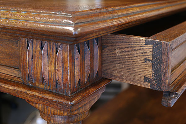 Top drawer and carved detail, on James 1st style oak court cupboard.