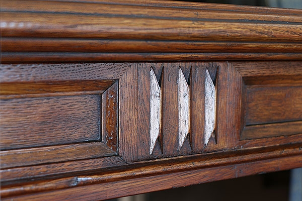 Mouldings & drawer carving detail on oak court cupboard