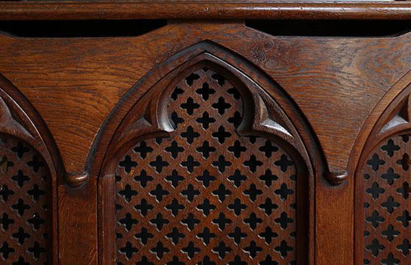 Lutyens Gothic style oak radiator cover detail.