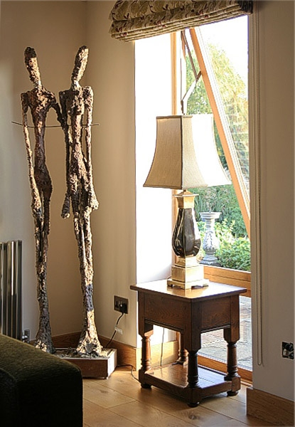 Traditionally styled oak lamp table in contemporary interior