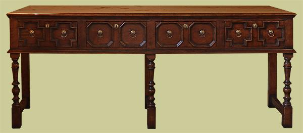 4 drawer Jacobean style oak open base low dresser.