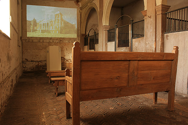 Oak settle and medieval style benches in the old stable block of Osterley Park.