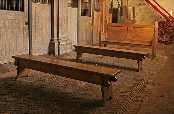 Oak benches and settle in the old stable block of Osterley Park.