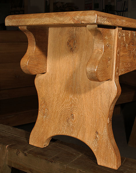 Detail view of medieval style oak bench, or form.