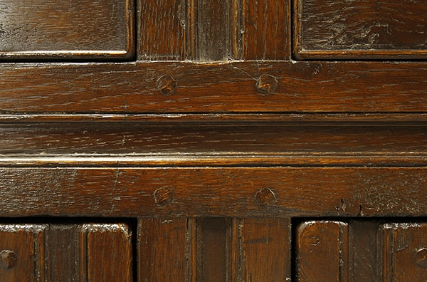 Close detail of period style 2-door open rack oak dresser
