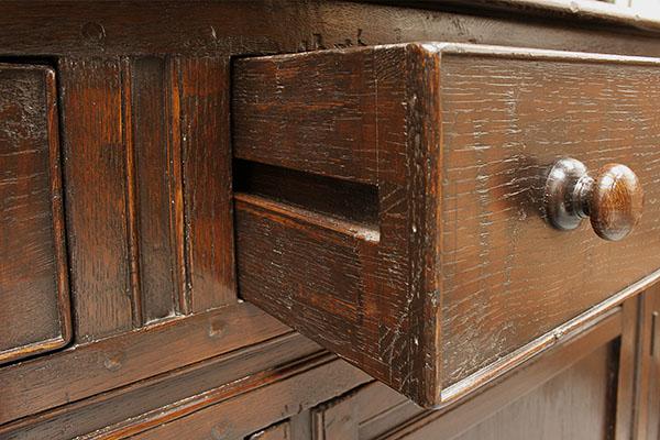 Drawer detail of period influenced oak high dresser.