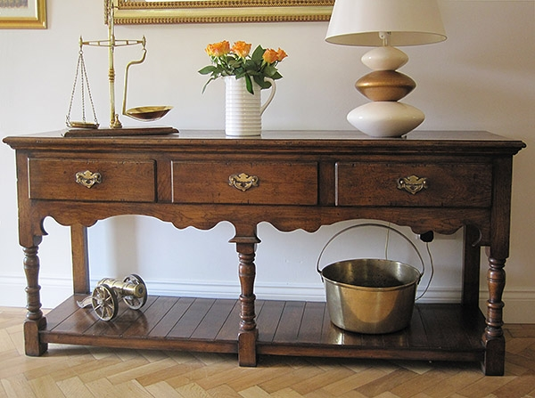 Antique style oak potboard dresser base in West Sussex home