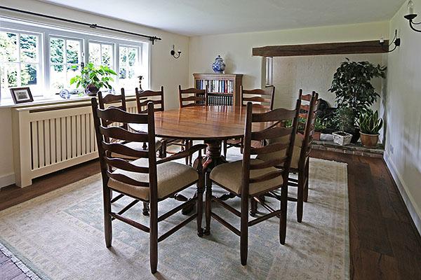 Oak dining furniture in period Sussex farmhouse.
