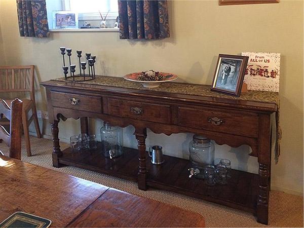 Replica antique potboard dresser base in clients Surrey home.