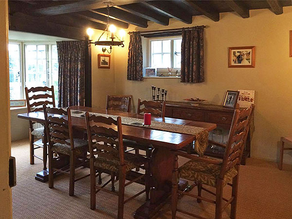 Restored antique country furniture in old Surrey manor house.